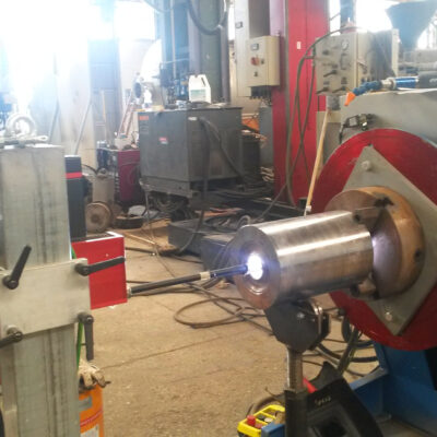 WELD OVERLAY ON NOZZLE EXECUTED BY HOT WIRE GTAW WITH ROTATING MANIPULATOR
